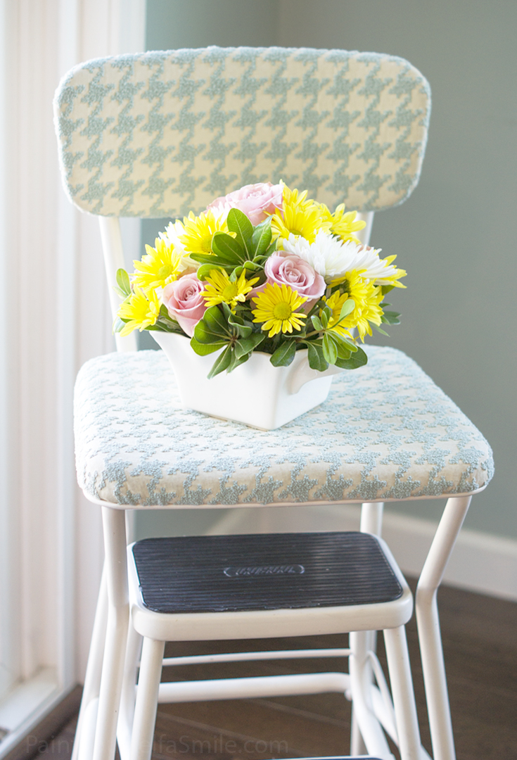 Vintage 60's stool gets a fresh look with some new fabric and paint. tutorial on the blog