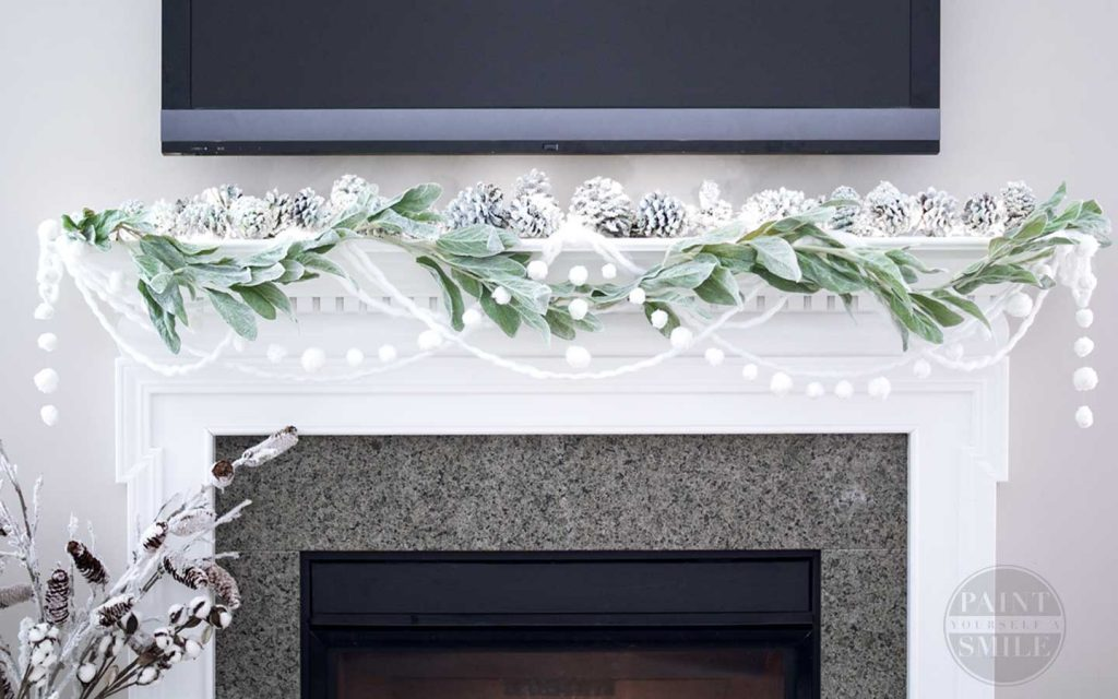 Gorgeous Winter mantle! DIY pom pom winter garland instructions from Paint Yourself A Smile
