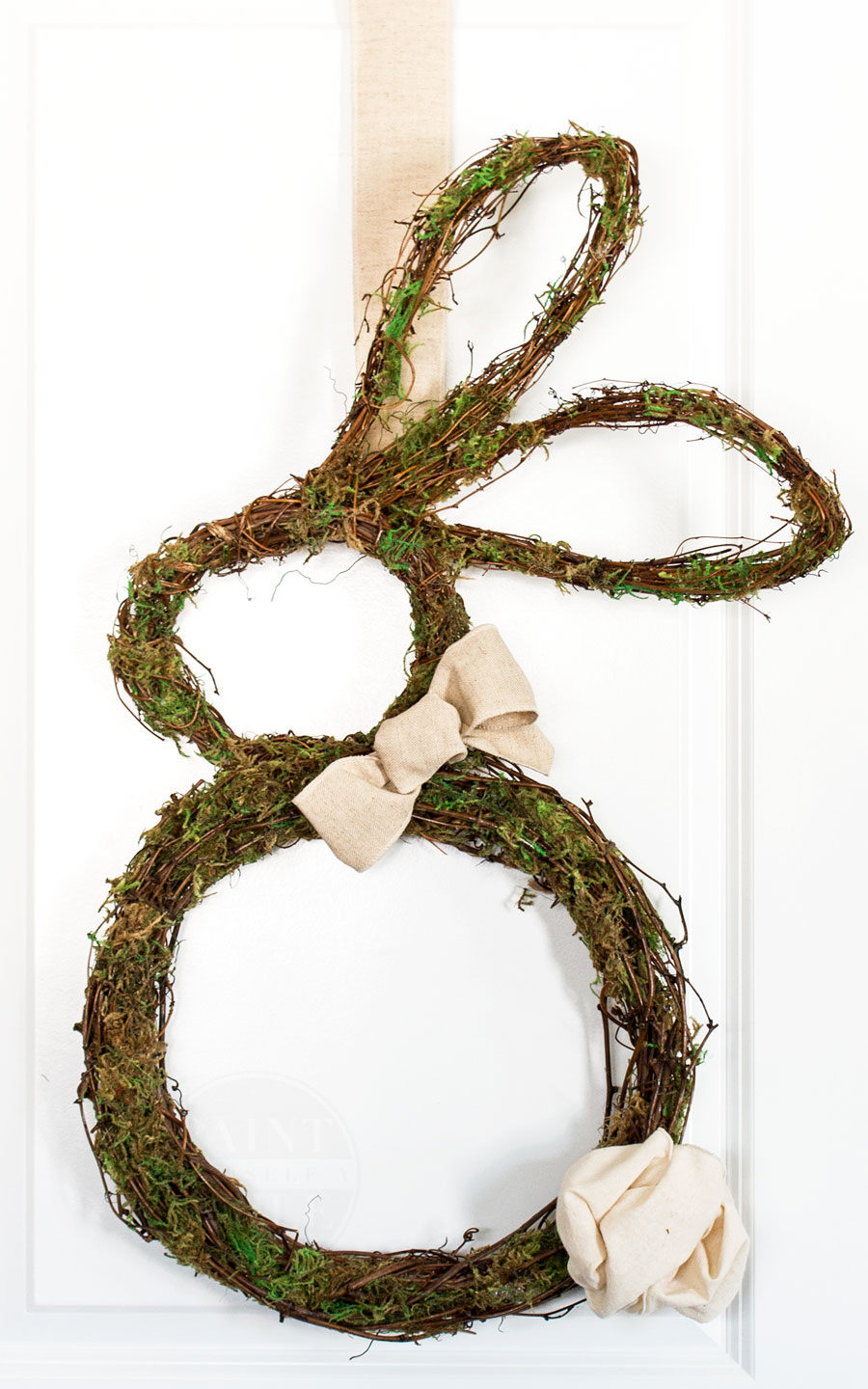 Super Cute Easter Bunny shaped grapevine door wreath with all the DIY how to instructions