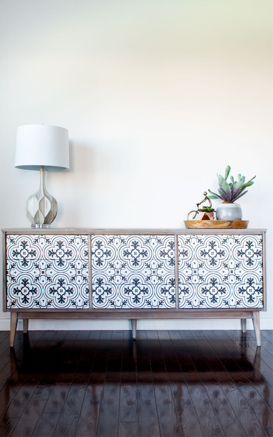Awesome DIY MCM Dresser / Buffet Makeover using vintage cement tile pattern. I love custom painted mid-century modern furniture.