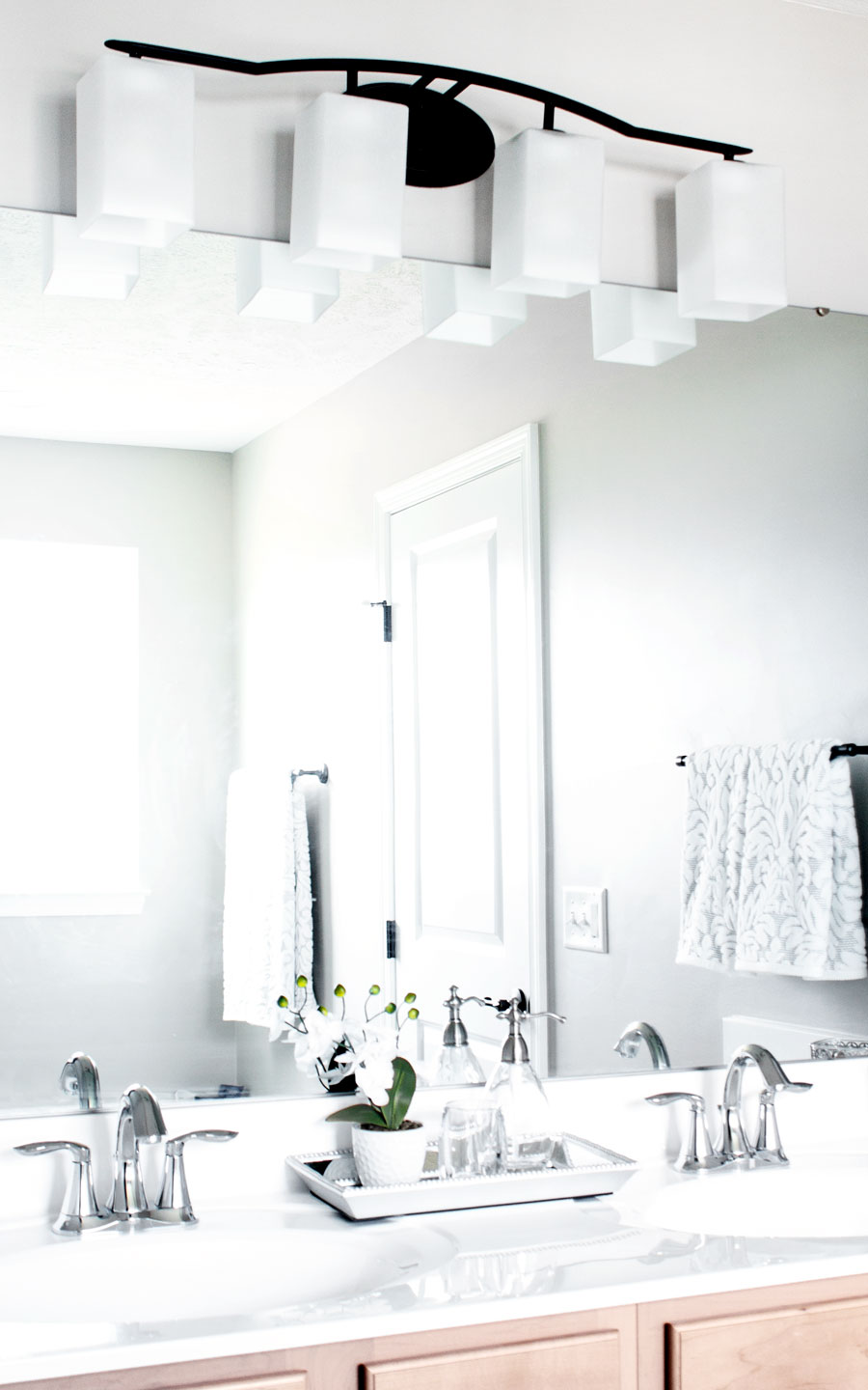 Inexpensive lighting & mirror options to make over a bathroom on less than $100. #$100 challenge